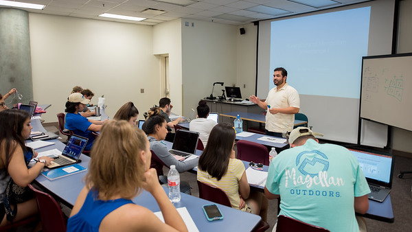 Dr. Gonzales delivers a lecture to his Genetics class.