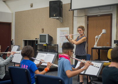 Dr. Snipes guides camp attendees through a musical piece during Islander Band Camp.