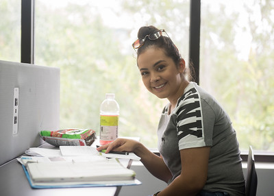 Yasmin Pinon works on her project in the @Mary and Jeff Bell Library.