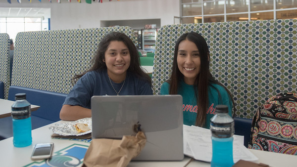 Bianca Coriez (left), and Paola Lopez study together for their microbiology class in the Rotunda at the University Center.