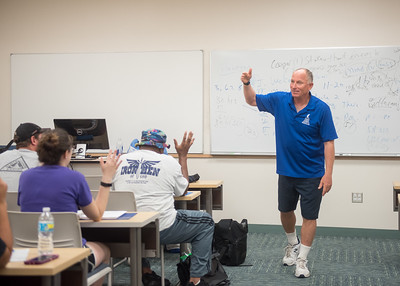 Dr. Lon Seiger asks students a question while explaining a project for Exercise and Health.