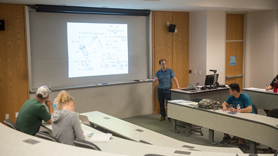 Assistant Professor Dr. Iltai Kim explains a formula during his Fluid Mechanics lecture.