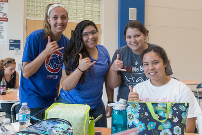 Katelyn Kelso (left), Coretta Torres, Andri Cordova, and Celeste Garcia show us their best Shakas in Island Hall.