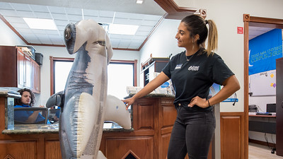 Hunter checks out the Welcome Center with student worker Laraine Shawa as she tells him about the benefits of being an Islander.  Join us in celebration of Shark Week at Brewster Street Icehouse: http://bit.ly/2taqLoa
