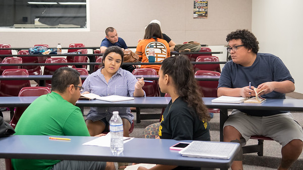 Monica Saldaña (back, left) discusses character traits with her peers Rudy Alvarez (left), Amanda Esparza, and Alejandro Almendarez during their Literature and Culture class in the Center for Instruction.