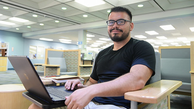 Isiah Morales works on his homework for his Psychology class in the Mary and Jeff Bell Library.