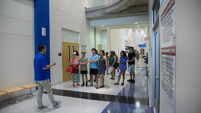A student worker from the Islander Welcome Center walks with prospective students and their families through the Dugan Wellness Center into Island Hall.   FMI on how to schedule a tour of the Island University: http://bit.ly/2vrHRAg