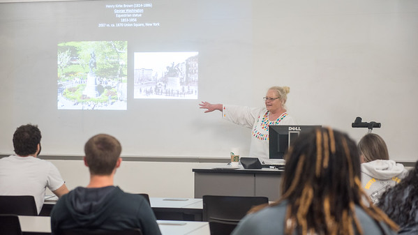 Dr. Carey Rote, Professor in the College of Liberal Arts, goes over variations of the equestrian statue during her Art of the United States lecture.