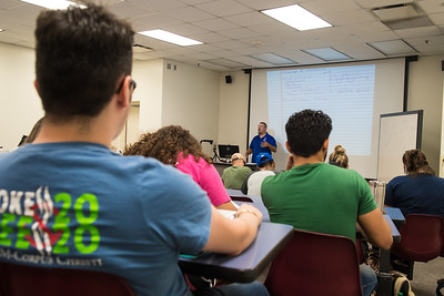 Professional Assistant Professor, Dr. Jeffery Spirko explains a lesson in his  General Physics II class.