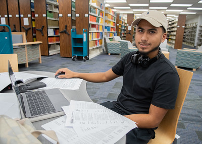 Ramon Muniz utilizes one of the many study spaces on the first floor of the Mary and Jeff Bell Library to work on his Physical Geology assignments.