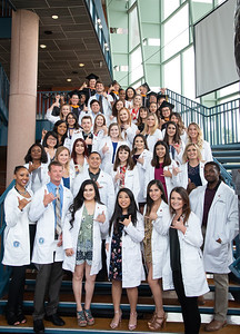 Nursing students threw up their best shakas as they pose for a group picture during the College of Nursing and Health Sciences White Coat Ceremony.  Click on the link to read more about the White Coat Ceremony: http://bit.ly/2yyyLHh