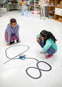 Aarthi Palaniappan (left) and Sarika Yarrabolu direct their mBot along a curved line during the Girls Code Camp.  Check out other summer camps available for kids and teens: http://bit.ly/2MighNt