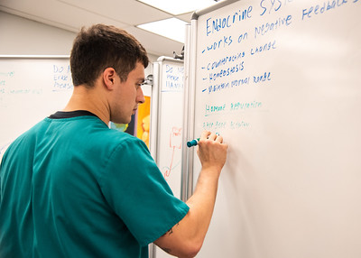 Nathan Millard uses the dry erase boards located in the Mary and Jeff Bell Library to prepare for his upcoming exams.