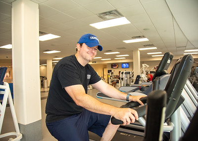 Glen King begins his workout by doing some cardio exercises in the gym located on the second floor of the Dugan Wellness Center.  For summer gym hours, fitness classes, equipment rentals, and more: https://recsports.tamucc.edu/