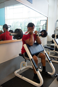 Student Kai Paul utilizes the Dugan Wellness Center's accessible free weights to work on his strength and conditioning.