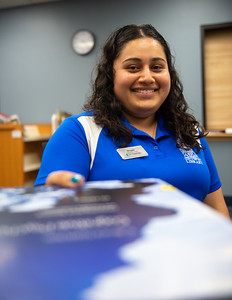 Student worker Magda Chavez is always happy to assist with checking out books at the Mary and Jeff Bell Library.