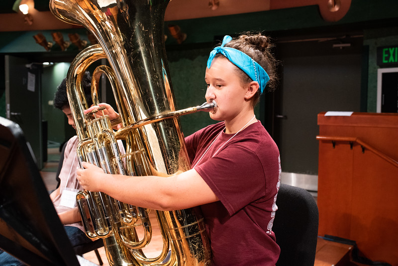 """Natalie Albcecht performs """"Creed"""" with her tuba as part of the Islander Band Camp rehearsal held in the Performing Arts Center."""