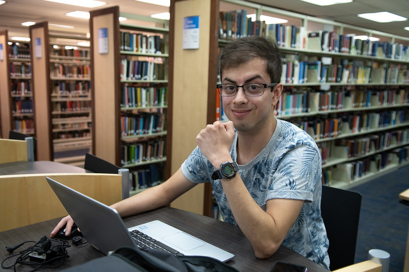 Nicolas Alaniz sits down at Mary Jeff Bell Library study area to work on his accounting homework as he prepares for his finals this week with ending summer one classes