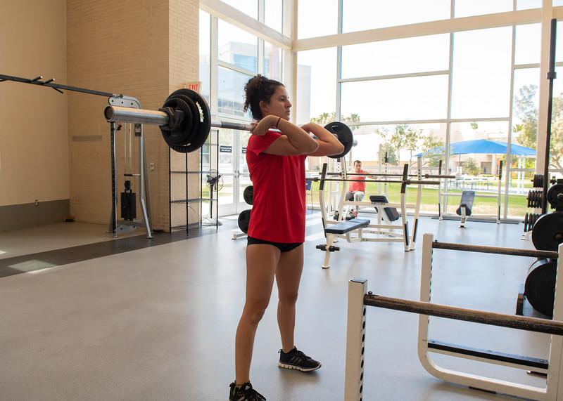 Kendall Moody works on hang cleans on the first floor of the Dugan Wellness Center.