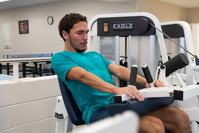 Sam Siquiros focuses on his leg curl-ups on the second floor of the Dugan Wellness Center.