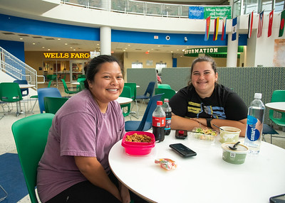 Jamie Matise (left) and Yulissa Heinlich stop to eat lunch in the University Center   Rotunda before their next class.
