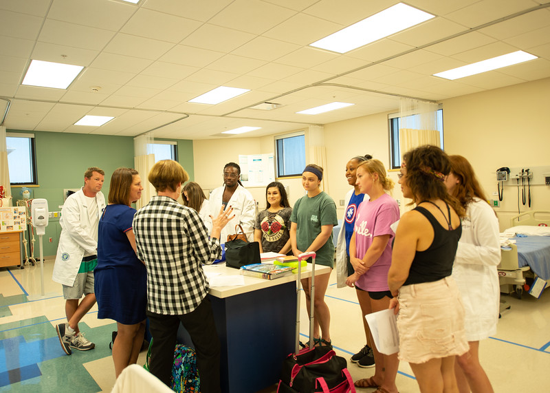 Dr. Miller conducting her summer Health Assessment course in Islander Hall's upstairs mock hospital