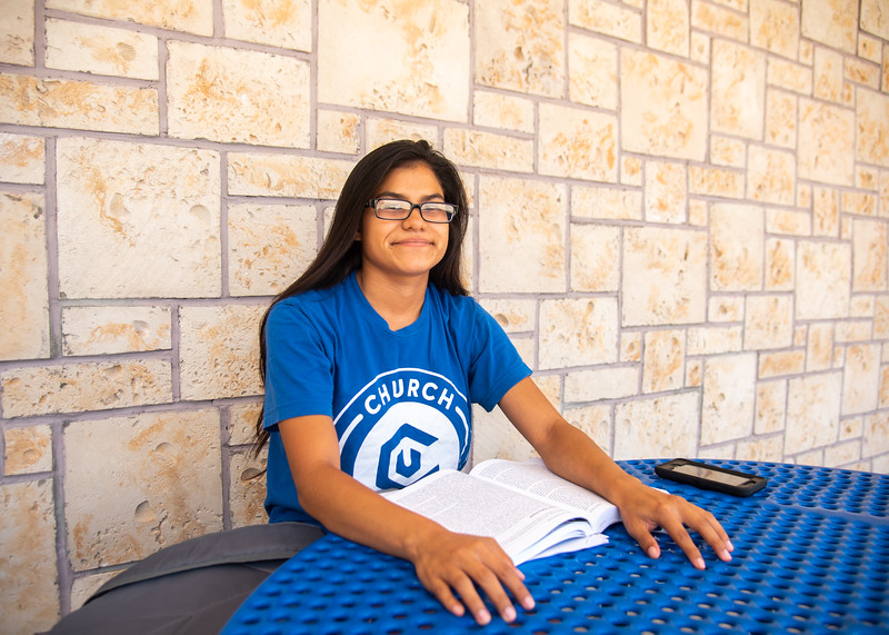 Benita Zalazar studies for her Criminal Justice exam outside Corpus Christi Hall.