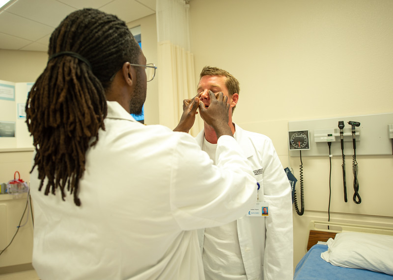 McAllen Waobikeze (left) and Steve Wright partner up as they conduct a physical examination lab.
