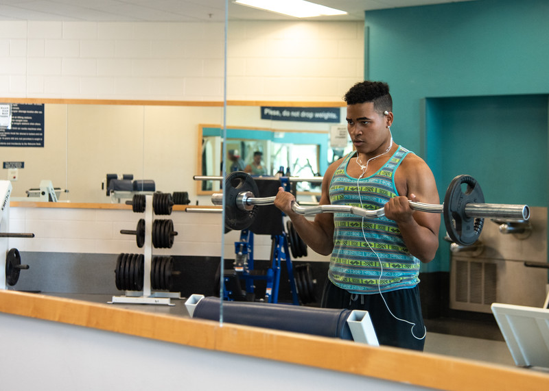 Marcus Anthony utilizes the available weights in the Dugan Wellness Center for his daily workout.
