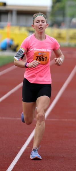 Record-Eagle/James Cook Nicole Mancini , or Warrenton, Va., won the women's 10K race at Saturday's Bayshore Marathon.