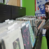 Record-Eagle/Douglas Tesner<br /> Aaron Gooch, co-owner of Sound It Out Records, sorts records. In May, the store is moving to a new location in Old Town.