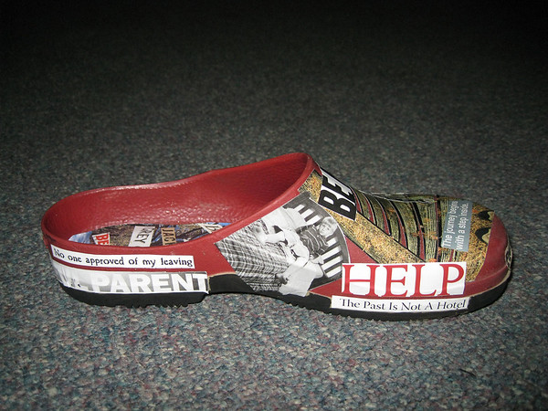 "Record-Eagle/Jodee Taylor<br /> A clog featuring words and phrases cut from magazines is part of the ""In Her Shoes"" exhibit by victims of sexual assault."