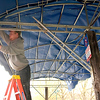 Record-Eagle/Jan-Michael Stump<br /> Advanced Awnings assistant Kody Sheffield(front) and manager Doug Saul (back) put up awnings for the Sarah Hardy Farmers Market in Traverse City on Tuesday morning. The two placed 17 of the 20-foot by 10-foot awnings for the market, which will open for the season on Saturday, May 8.