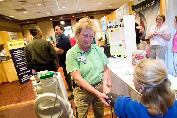Record-Eagle/Jan-Michael Stump<br /> Debbie Link, R.N., takes the blood pressure of Susan Steben, of Beulah, at the Paul Oliver Memorial Hospital booth during the Benzie Chamber of Commerce Expo 2010.