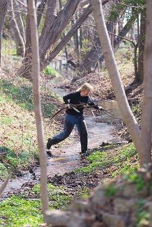Record-Eagle/Jan-Michael Stump<br /> Heidi Harwell removes fallen branches from a stream.