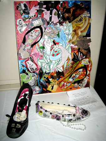 "Record-Eagle/Jodee Taylor<br /> Shoes, a collage and a poem are part of the ""In Her Shoes"" exhibit, which hopes to increase awareness of domestic violence."
