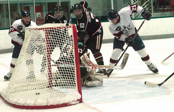 Record-Eagle/Douglas Tesner<br /> Kellin Ainsworth (27) scores from the left side as Eric Rivard (25) blocks the Motor City net on Friday.