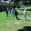 Record-Eagle/Douglas Tesner<br /> Kathy Radakovich's first-grade students scatter across school grounds on Thursday to pick up trash as part of their Earth Day activities at Eastern Elementary School.