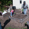 Record-Eagle/Douglas Tesner<br /> Jon Roth, his wife Elizabeth and their two daughtesrs Anna, 12, and Mary, 8, work on the family garden. They used the garden to grow food for the family and reduce their carbon footprint.