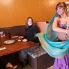 "Record-Eagle/Douglas Tesner<br /> Carmen Torres, a Middle Eastern dancer known as ""Amaya,"" dances for customers Emma and Megan Schrider at the new downtown Zakey restaurant. Torres also dances at Zakey's Three Mile location, which opened two years ago."