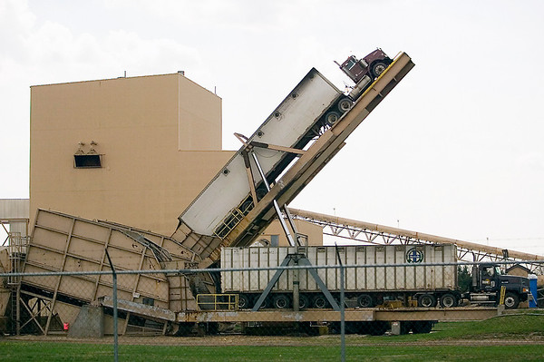 Record-Eagle/Jan-Michael Stump<br /> A truck is tilted to deliver a load of wood chips to Cadillac Renewable Energy. The plant burns waste wood to heat boilers to produce steam and turn turbines to generate electricity that's sold to Consumer's Energy Company.