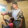 Record-Eagle/Douglas Tesner<br /> Jon Roth, one of his daughters, Mary, 8, check the insulation they added to the basement walls.