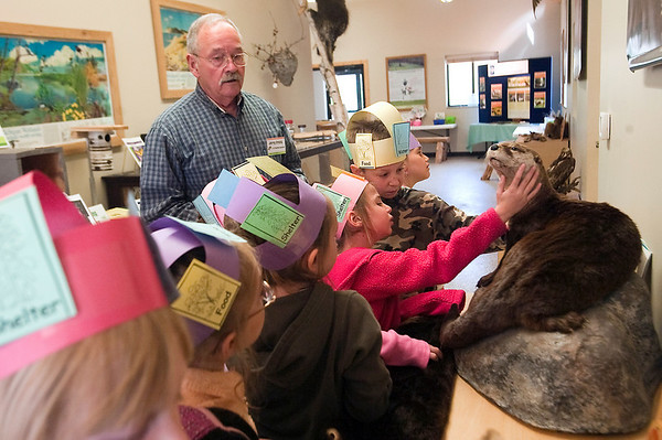 Record-Eagle/Douglas Tesner<br /> Jerry Freels, a volunteer at Boardman River Nature center, tells first-graders from Betsie Valley elementary School about otters. More than 30 first- graders took part in the Earth Day field trip.