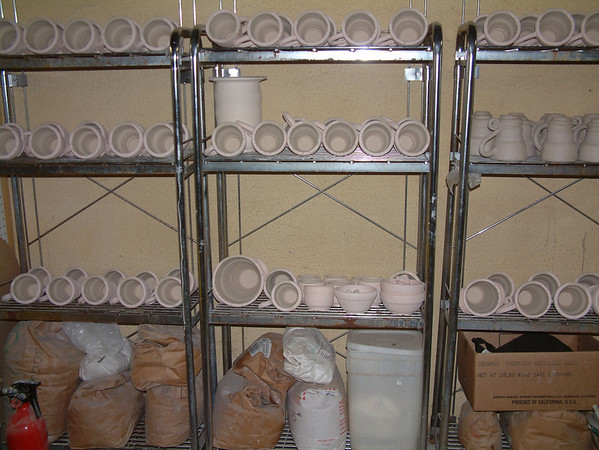 Record-Eagle/Marta Hepler Drahos<br /> Shelves of pottery await firing at Todd Springer's Quarry Mountain Clayworks studio.