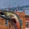 Record-Eagle/Jan-Michael Stump<br /> Kalkaska's trout statue and a banner for the upcoming National Trout Festival sit in the village's downtown.