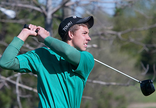 Record-Eagle/Douglas Tesner<br /> Traverse City West's Chris Dienes keeps an eye on his shot at the Tee-Off.
