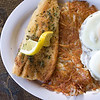 Record-Eagle/Jan-Michael Stump<br /> Trout and Eggs at Kalkaska's Trout Town Cafe features a rainbow trout filet, two eggs, hash browns and choice of toast, biscuit or pancakes. Oat bran cherry toast, seen here, is available at an extra cost.