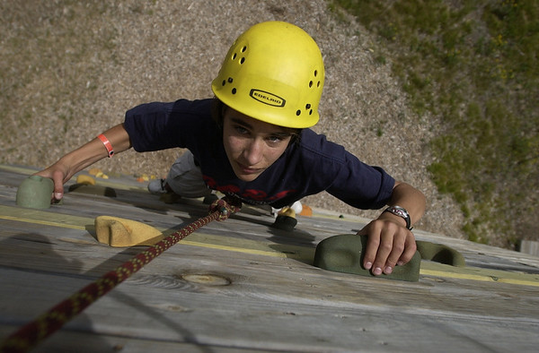 Record-Eagle/Garret Leiva<br /> Eric Hosler, a Boy Scout with Troop 7 in Petoskey, climbs the 32-foot climbing tower at Camp Greilick.