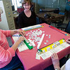 Record-Eagle/Douglas Tesner<br /> From left, Bette Schaefer, Anne Havill and Louise Kane take part in a mah-jongg game at the Traverse City Senior Center.