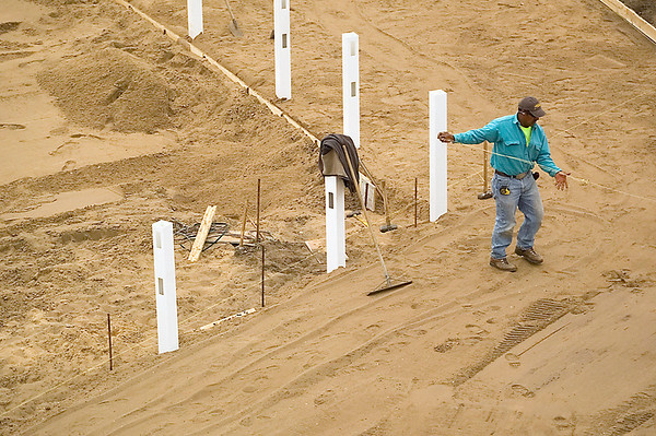 Record-Eagle/Jan-Michael Stump<br /> Gilberto Vera, of Grand Traverse Construction, works on a pathway near the west end zone at Thirlby Field. Work is ahead of schedule at the field.